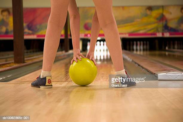teenage girl (16-17 years) holding bowling ball, rear view, low section - 16 17 years stock pictures, royalty-free photos & images