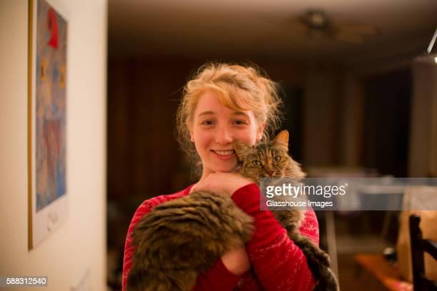 Teenage Girl Holding Cat, Portrait