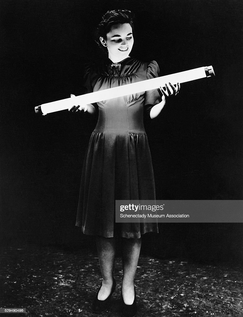 Teenage Girl Holding GE Fluorescent Lamp Pictures | Getty Images for Girl Holding Lamp  67qdu