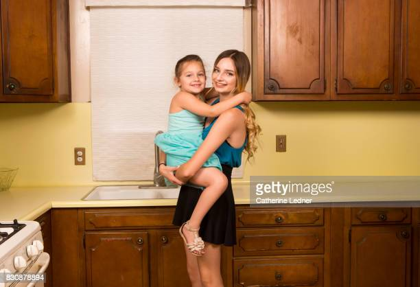 teenage girl holding her young cousin. - monrovia california stock pictures, royalty-free photos & images