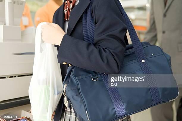 teenage girl holding plastic bag - ビニール袋 ストックフォトと画像