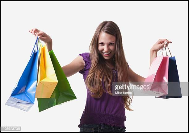 Teenage girl holding shopping bags