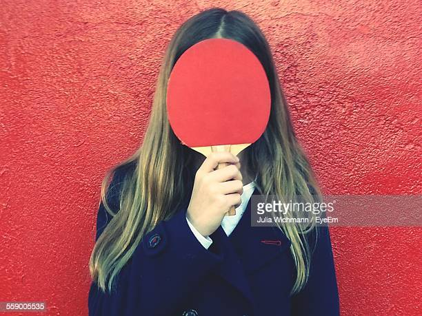 Teenage Girl Holding Table Tennis Racket