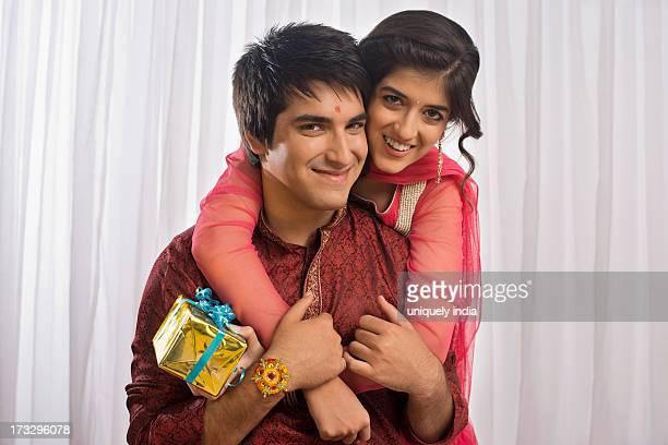 Teenage girl hugging her brother at Raksha Bandhan
