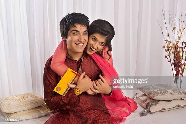 teenage girl hugging her brother at raksha bandhan - raksha bandhan stock photos and pictures