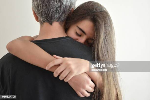 Teenage girl hugging her father