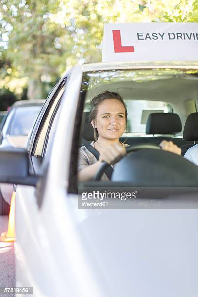 Teenage girl in a driving school car