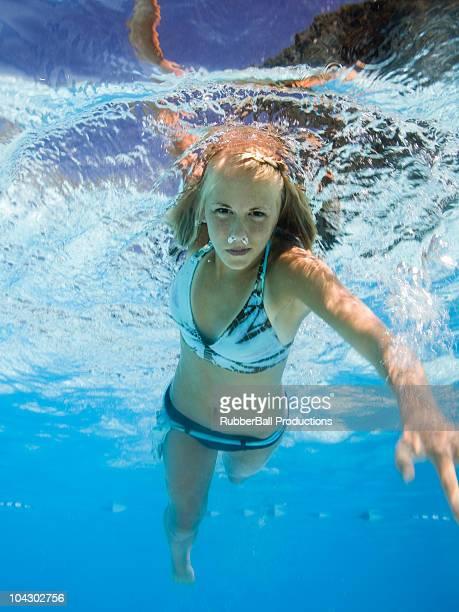 teenage girl in a swimming pool