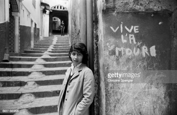 Teenage girl in an alleyway in the Casbah of Algiers