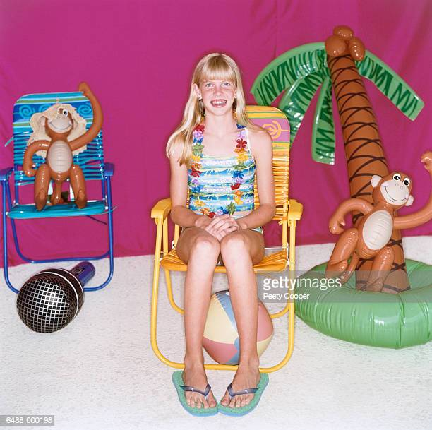 teenage girl in beach chair - monkey shoes stock photos and pictures