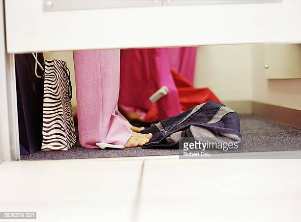Teenage girl (17-19) in changing room, low-section