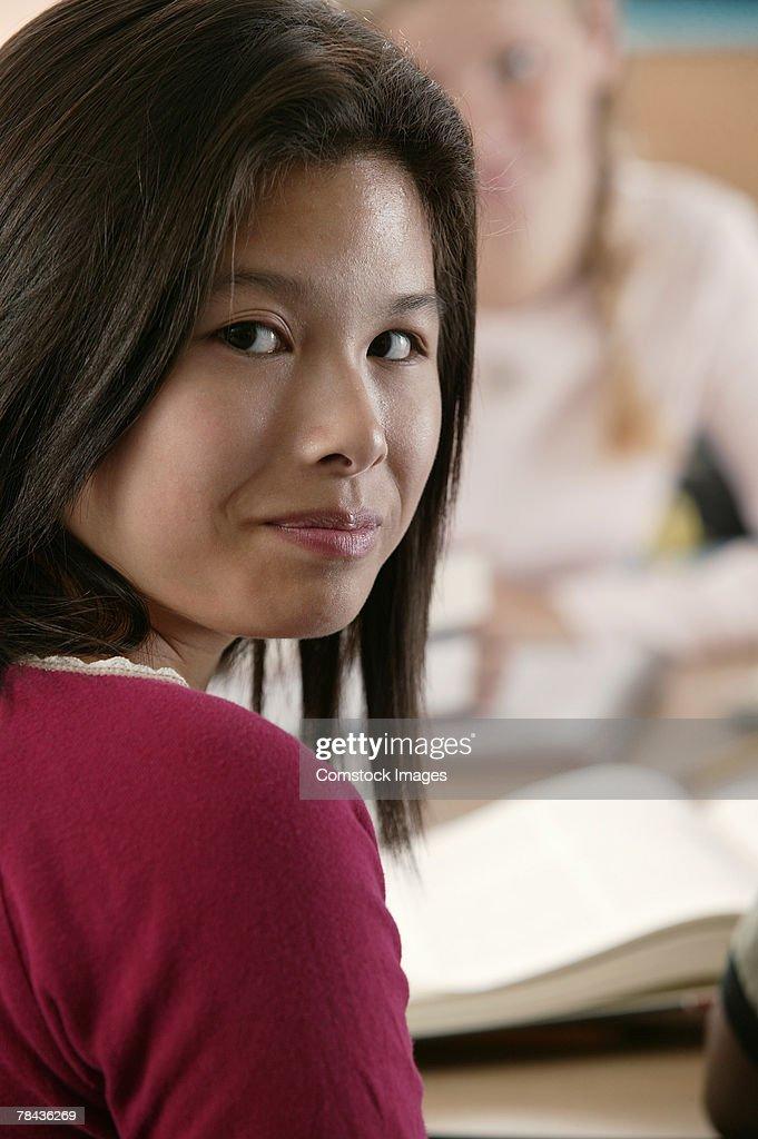Teenage girl in class : Stockfoto