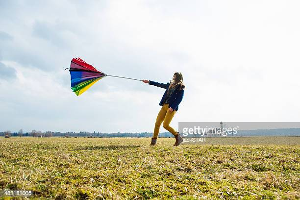 teenage girl in field with umbrella - inside out stock pictures, royalty-free photos & images