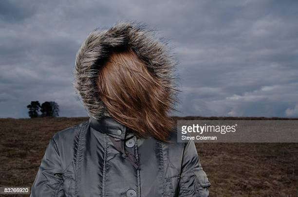 teenage girl in fur hooded coat - フード付きコート ストックフォトと画像