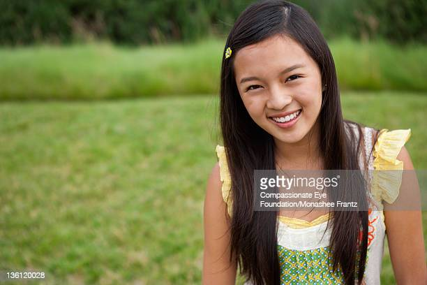 "teenage girl (14-15) in garden, portrait, smiling - ""compassionate eye"" stock pictures, royalty-free photos & images"