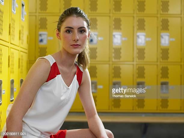 Teenage girl (14-16) in locker room, portrait