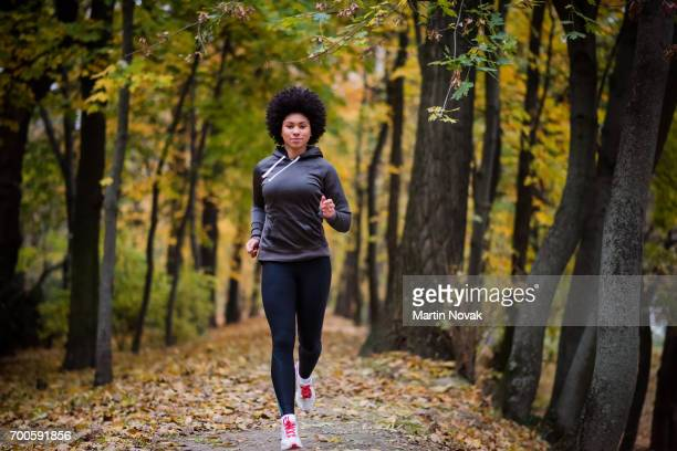 teenage girl in park running towards the camera - good posture stock pictures, royalty-free photos & images