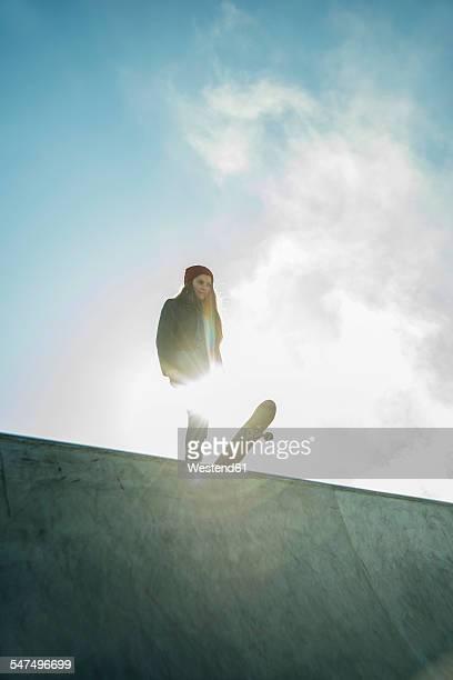 teenage girl in skatepark - skateboard stock-fotos und bilder