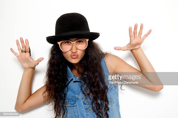 teenage girl in studio kissing camera - indian girl kissing stock photos and pictures