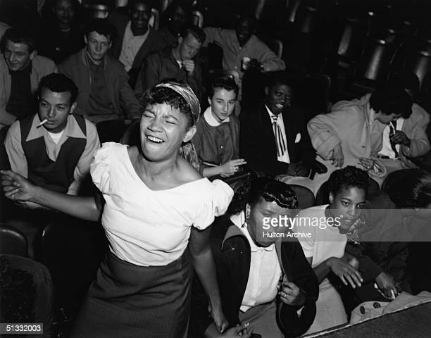 A teenage girl in the audience at 'Big Jay's Bop Session' dances to the music of Big Jay McNeely 1953