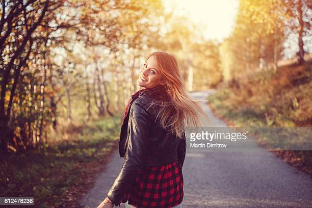 teenage girl in the autumn park - september stock-fotos und bilder