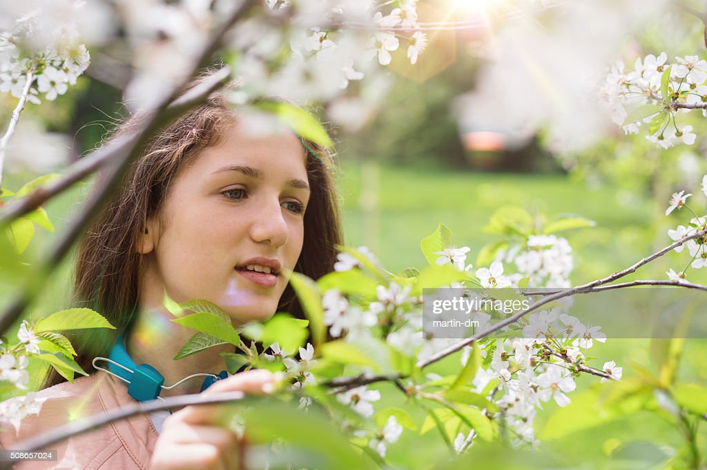 Teenage girl in the park : Stock Photo