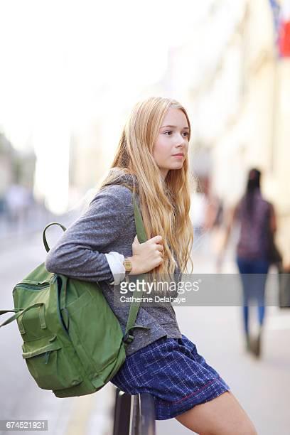 A teenage girl in the street