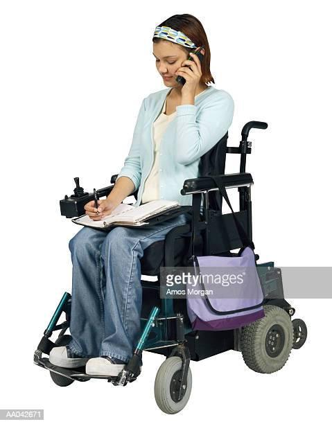 Teenage Girl in Wheelchair Uses Mobile Phone
