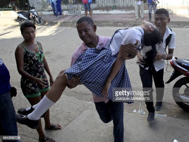 A teenage girl is brought to hospital in Carmen de Bolivar Bolivar Province Colombia after passing out on August 29 2014 Colombian health authorities...