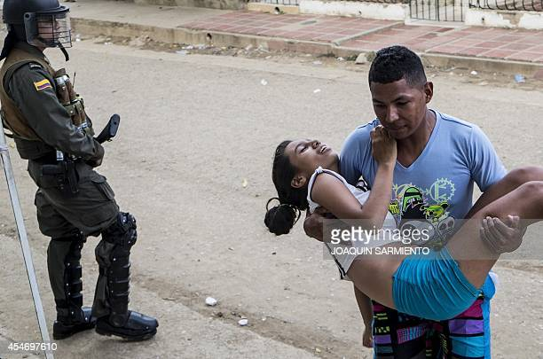 A teenage girl is brought to hospital in Carmen de Bolivar Bolivar Province Colombia after fainting on September 3 2014 Colombian health authorities...