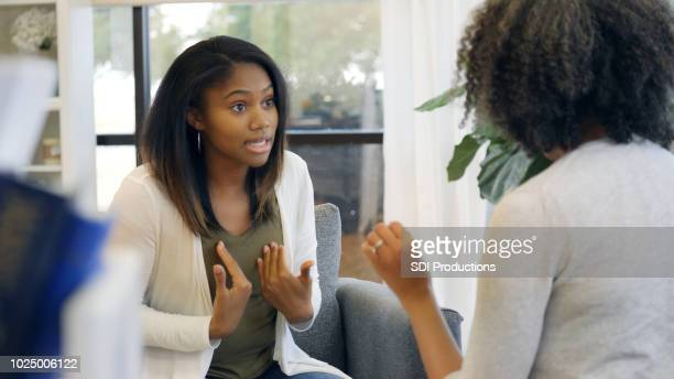 teenage girl is defensive during argument - defending stock pictures, royalty-free photos & images