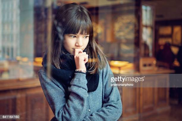 Teenage girl is looking museum exhibition