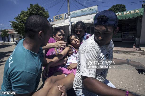 A teenage girl is taken to the hospital after fainting in Carmen de Bolivar Bolivar Deparment Colombia on August 30 2014 Colombian health authorities...