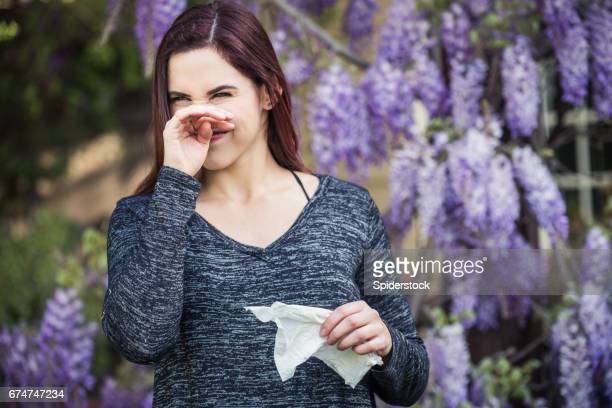 Teenage Girl Itching her Nose Ready to Sneeze