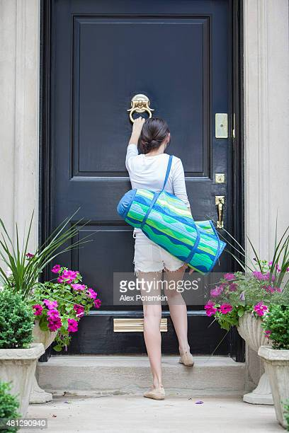 teenage girl knocks on the door - knocking on door stock photos and pictures