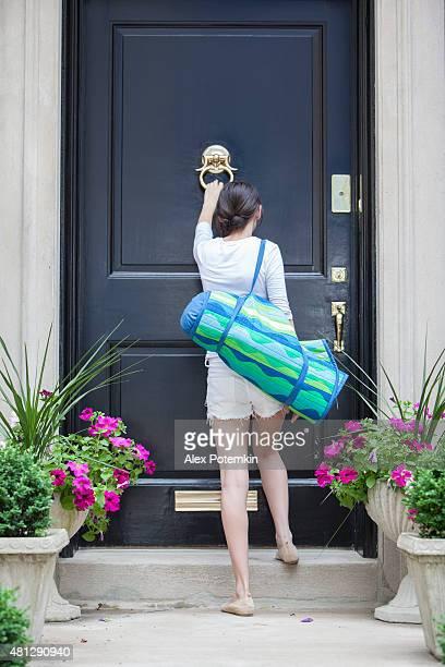 Teenage girl knocks on the door