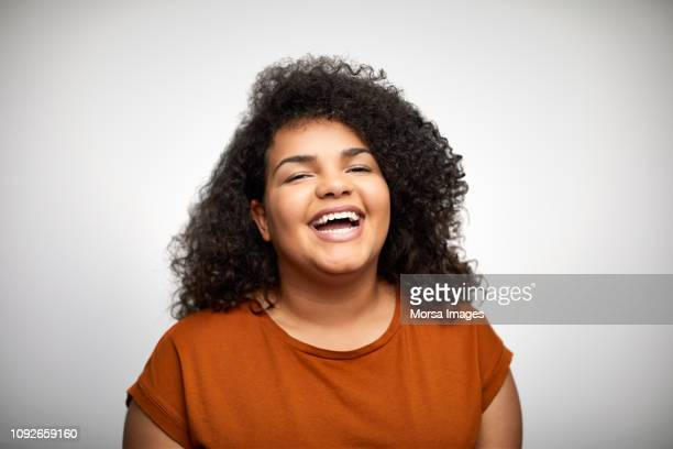 teenage girl laughing on white background - menina - fotografias e filmes do acervo