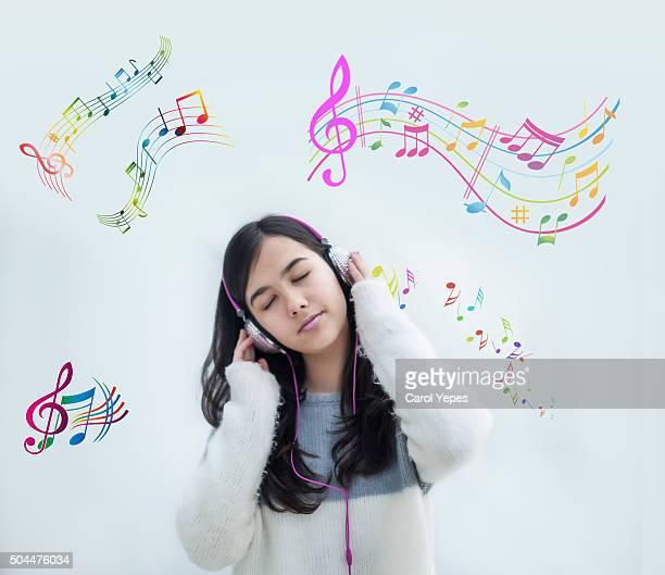 teenage girl listening music with headphones
