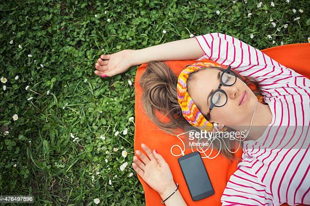 Teenage girl listening to music in the nature