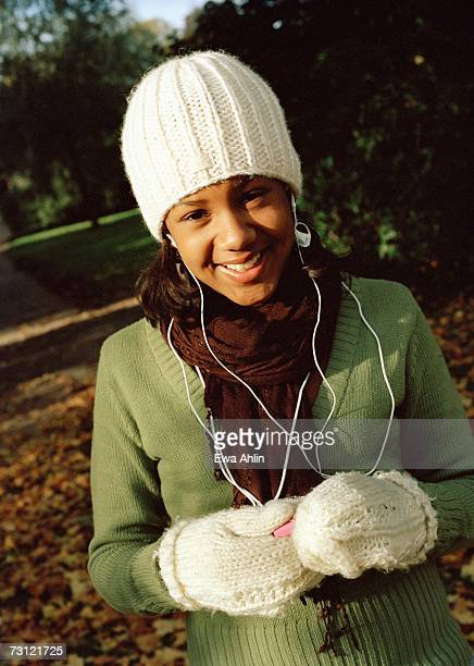 A teenage girl listening to music.