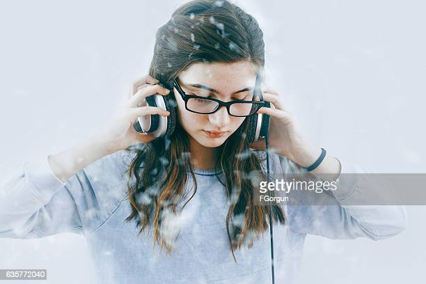 Teenage Girl listening to music with headphones