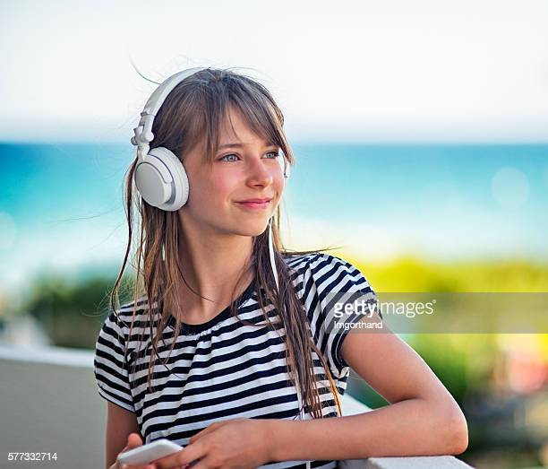 teenage girl listening to the music on balcony - imgorthand stock photos and pictures