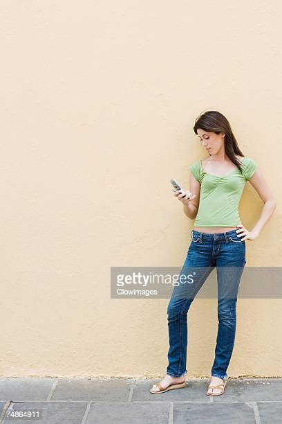 Teenage girl looking at a mobile phone