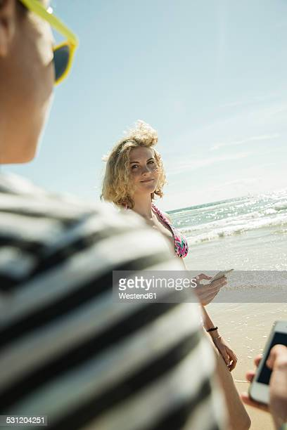 teenage girl looking at her boyfriend - camaret sur mer photos et images de collection