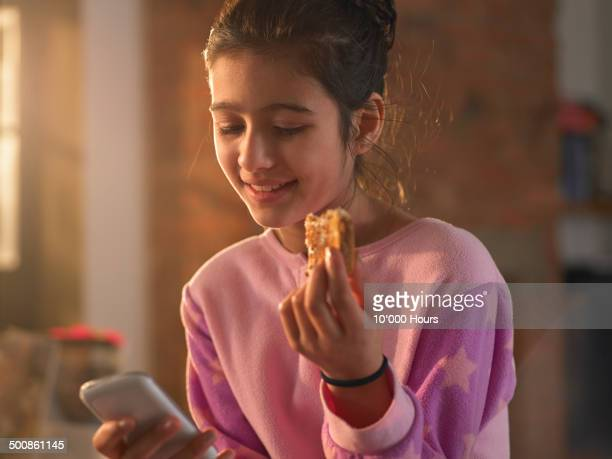 A teenage girl looking at her phone