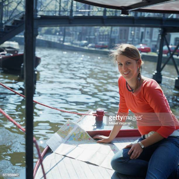 Teenage Girl Looking at Map on Boat