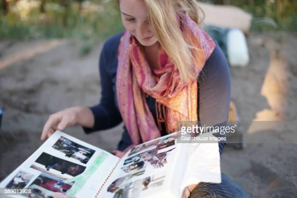 Teenage Girl Looking at Photo Album