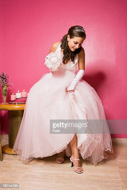 teenage girl looking at shoes - evening gown stock pictures, royalty-free photos & images