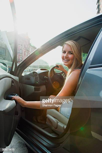 Teenage girl looking back from driver's seat