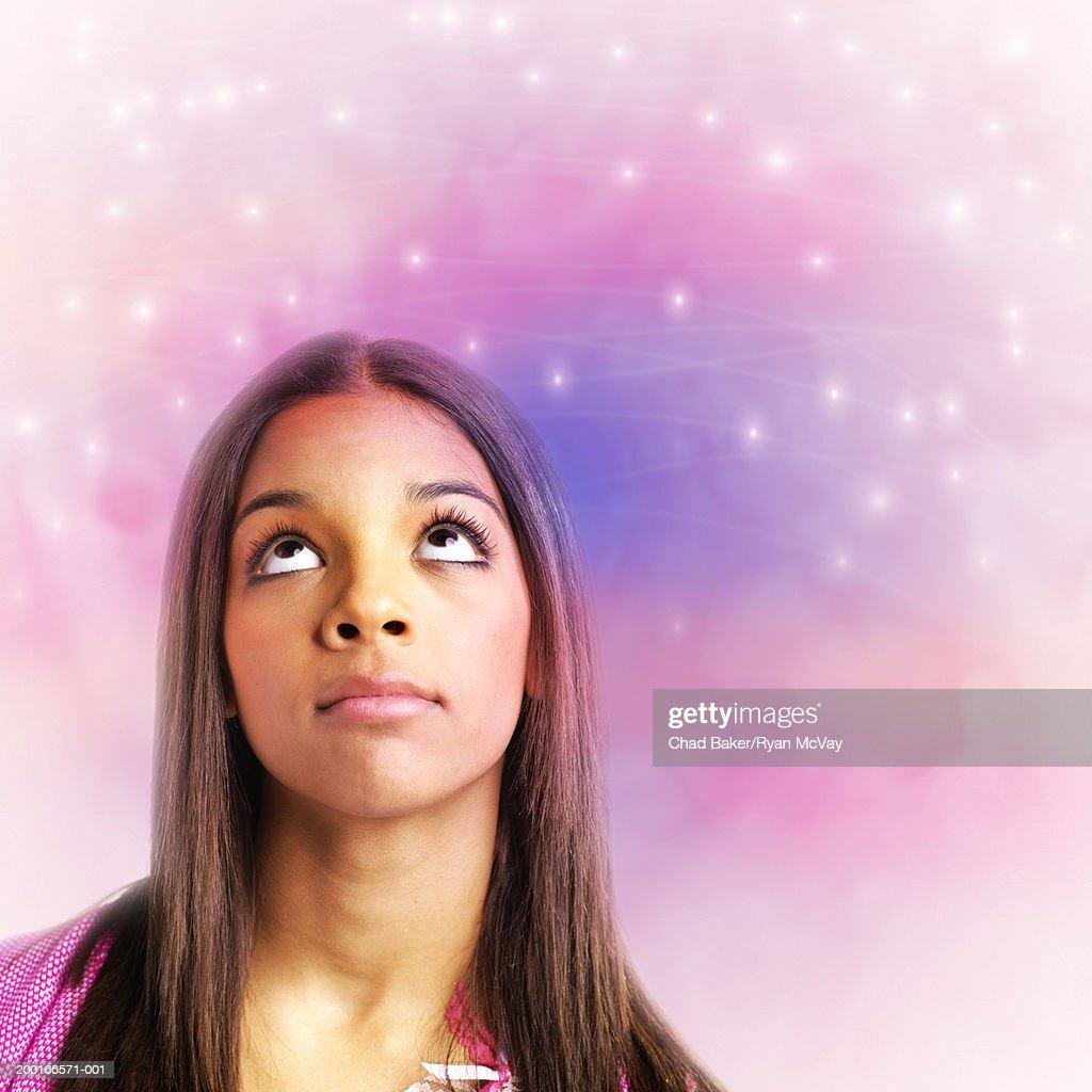 Teenage girl (13-15) looking up (Digital Enhancement) : Stock Photo